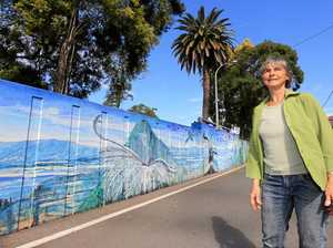 TIME FOR REVAMP: Adrienne Weber at the Murwillumbah flood levee mural.
