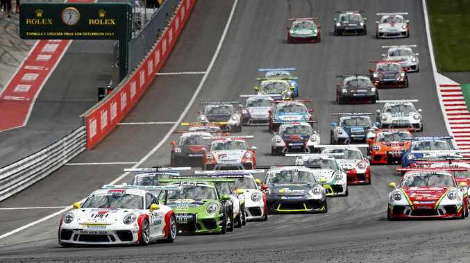 Matt Campbell (left) at the start of a race in this year's Porsche Mobil 1 Supercup.