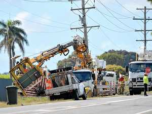 Derailed cane bin slams into power pole