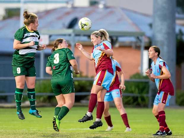Western Pride footballers battle with UQ in Sunday's NPL match at the Briggs Road Sporting Complex.