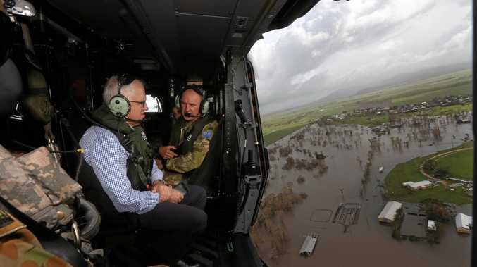 The Prime Minister Malcolm Turnbull flies over the cyclone damaged area of Bowen after Cyclone Debbie.