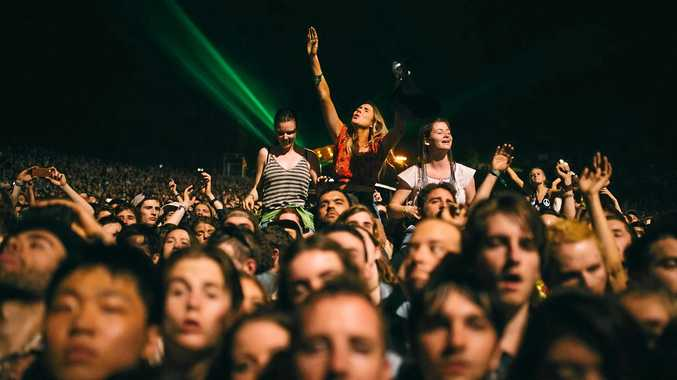 Crowds enjoy Tame Impala's show at the Splendour in the Grass 2015 festival.