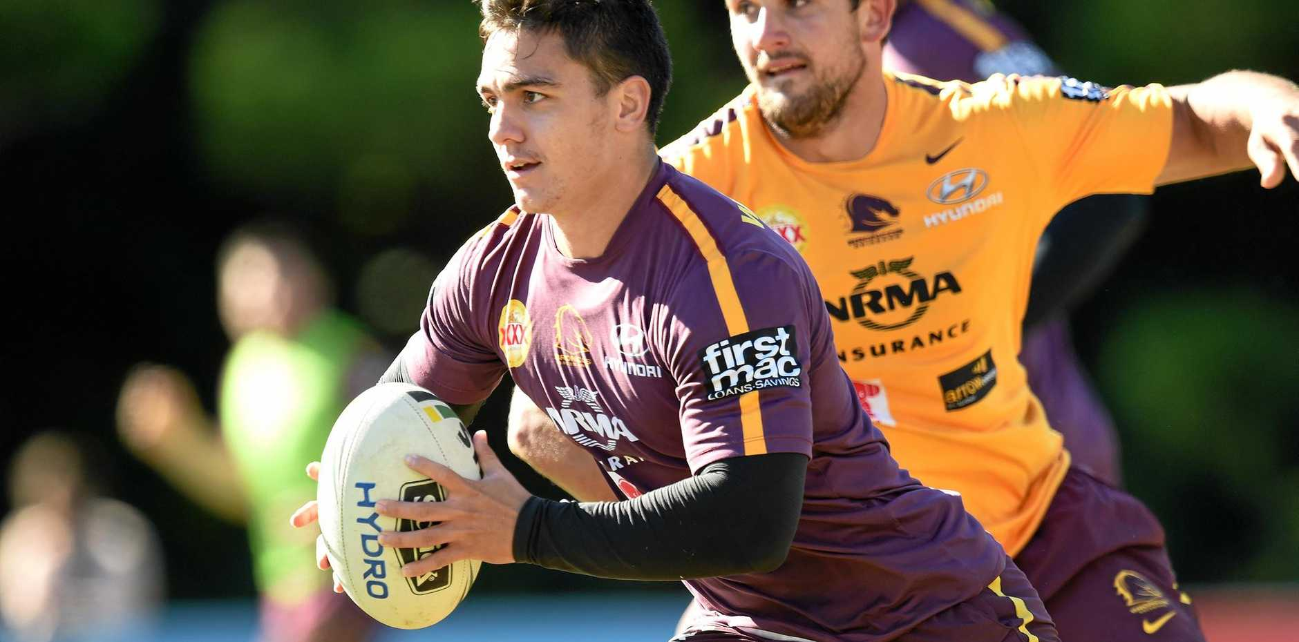 Kodi Nikorima (left) runs with the ball during the Brisbane Broncos training session at Red Hill