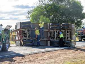 Lucky escape as truck trailer flips on Summerland Way