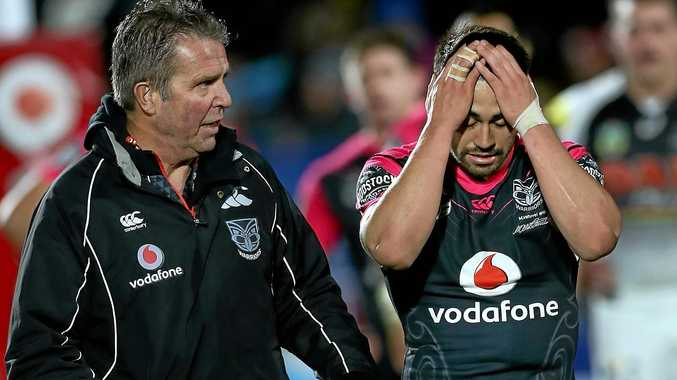 KNEE INJURY: Warriors halfback Shaun Johnson leaves the field with team doctor John Mayhew after suffering a PCL rupture in his left knee against the Panthers.