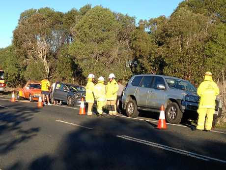 Emergency services on the scene of a two-vehicle crash outside Hervey Bay on Monday afternoon.