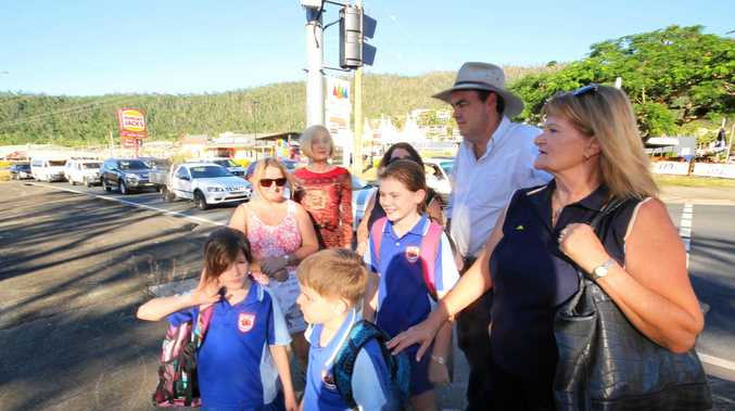 Shadow minister for education, Tracy Davis with member for Whitsunday Jason Costigan and Cannonvale State School P&C president Tina Everett, parents Jenni Walters, Beth Gilbert and students Kaley and Sienna Gilbert and Tomas Young wait to cross Shute Harbour Rd opposite Banjos.
