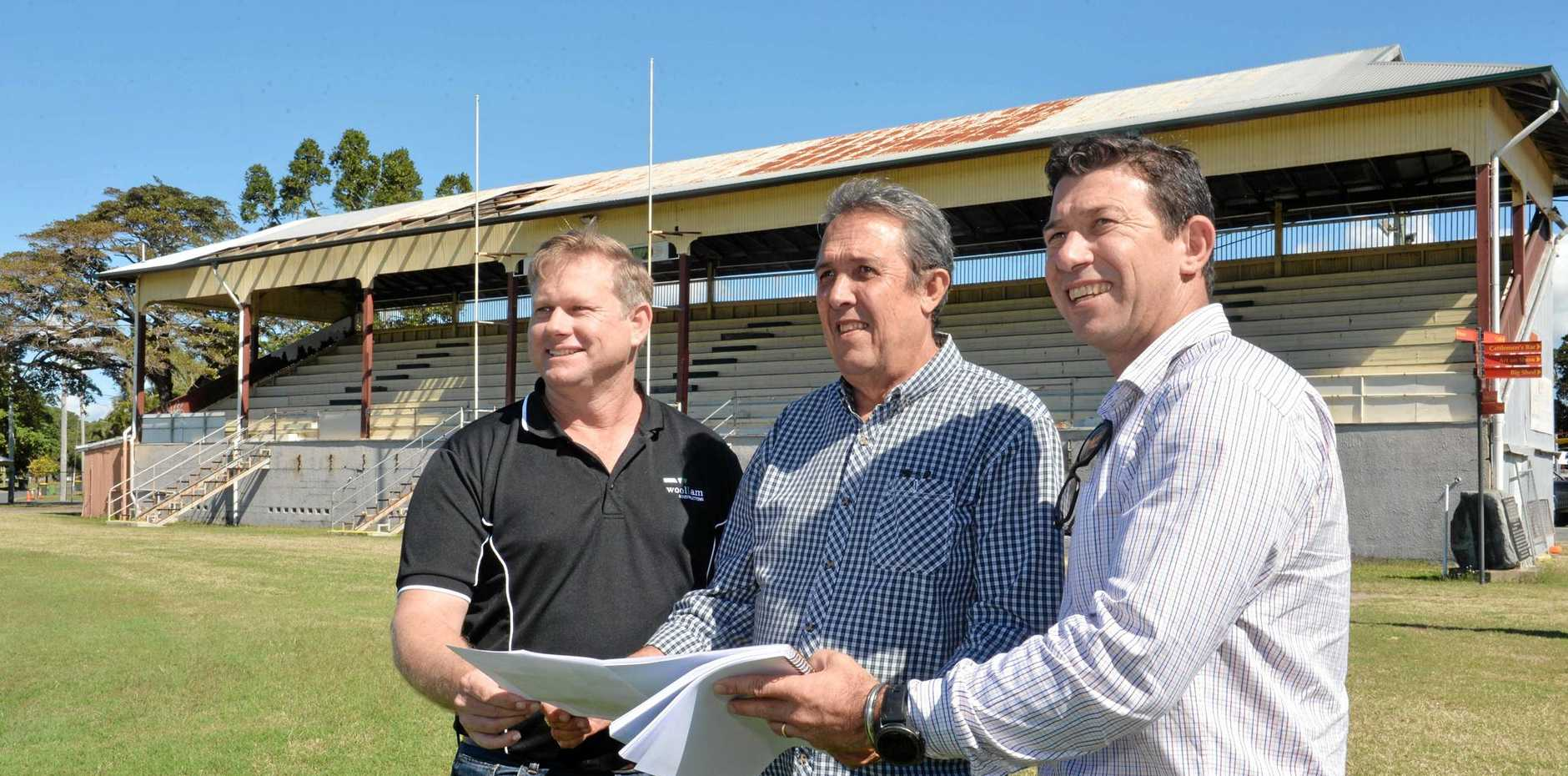 Woollam Constructions project manager Gary McLeod, Mackay Show Association manager Steve Gavioli and Woollam Constructions branch manager Peter Lando check plans for the upgrade at the Mackay showgrounds.