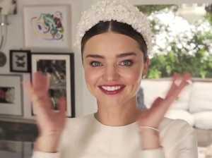 Miranda Kerr unveils wedding dress to Vogue
