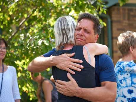 Don Damond hugs a neighbour after speaking to the media. Picture: Jules Ameel