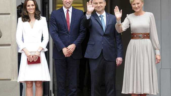 From left, Britain's Kate, the Duchess of Cambridge, Britain's Prince William, Poland's President Andrzej Duda and first lady Agata Kornhauser-Duda pose for photographers during a welcome ceremony, in Warsaw, Poland