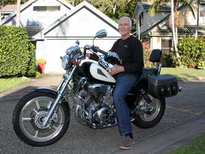 CLICKING ON: Ian Kinny aboard his Yamaha touring motorcycle. His eButton emergency call system allows people to make contact on the road or in the bush as well as at home.
