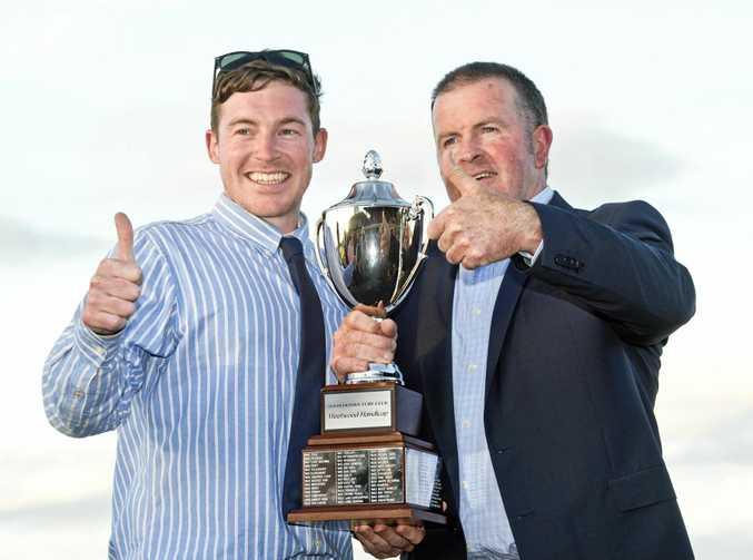 Trainer Ben Currie (left) celebrating his 2017 dead-heat Weetwood Handicap win with fellow trainer Michael Nolan.