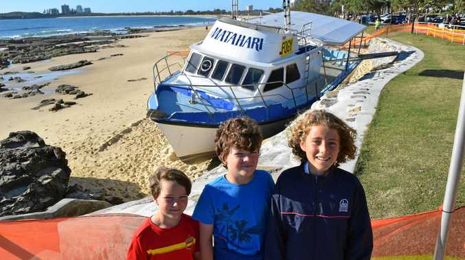 Carl Toren, Anna Toren and Darcy Cameron came to see the Matahari before it is removed from Mooloolaba Beach, where it ran aground on Saturday night.