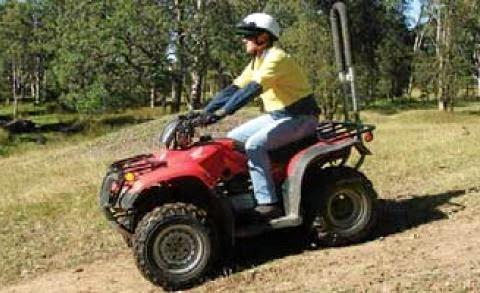 SAFE RIDING: An example of the correct way to ride a quad bike.