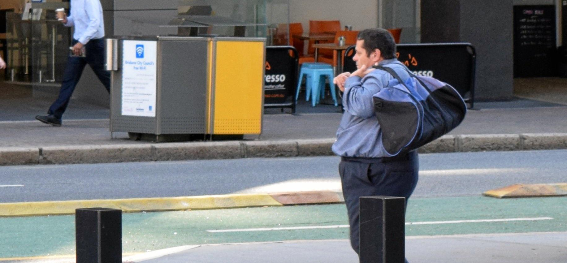John Frederick Manning of Bundaberg walks from the Brisbane Court of Appeal on Tuesday.