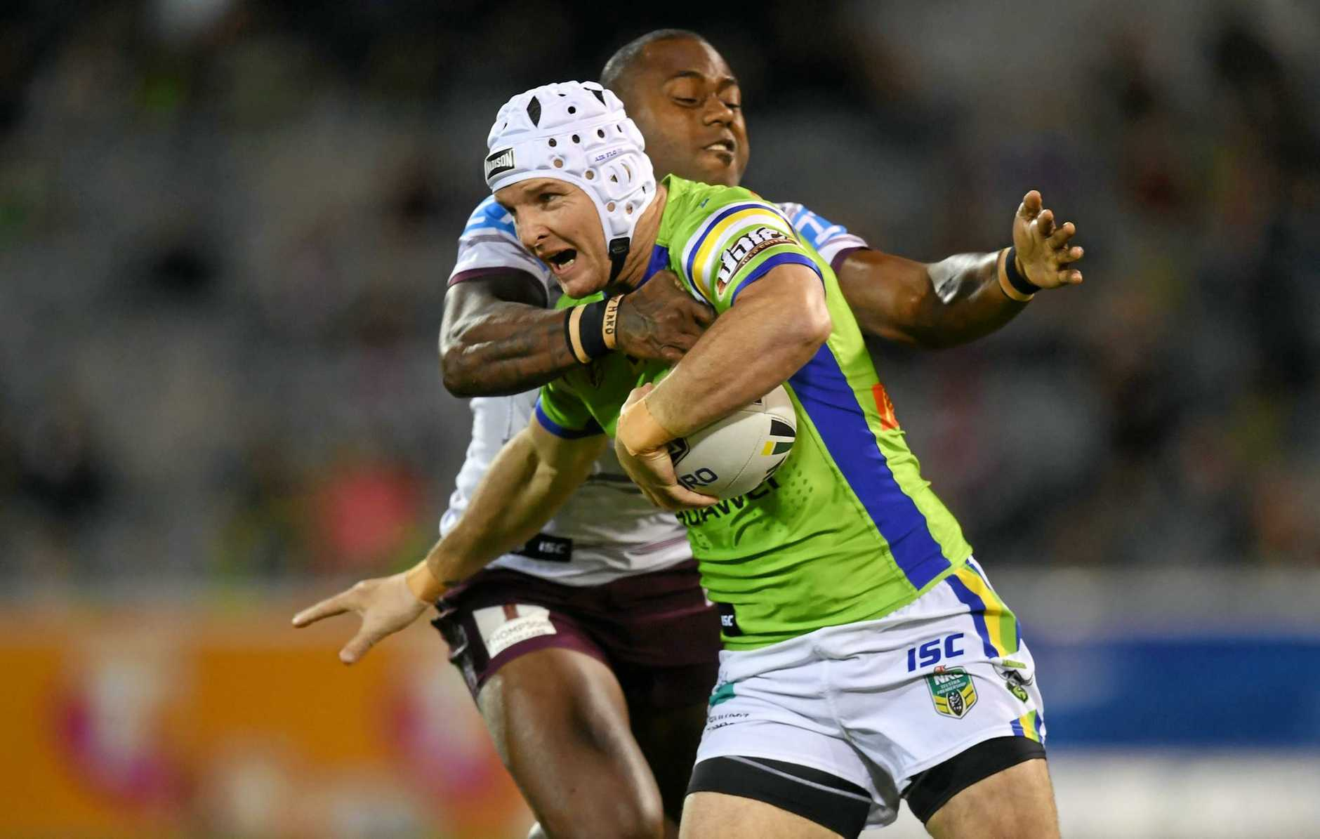 Jarrod Croker of the Raiders is tackled by Akuila Uate of the Sea Eagles.