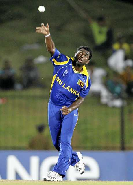Sri Lankan offspinner Muttiah Muralitharan bowls in the 2011 ICC Cricket World Cup.