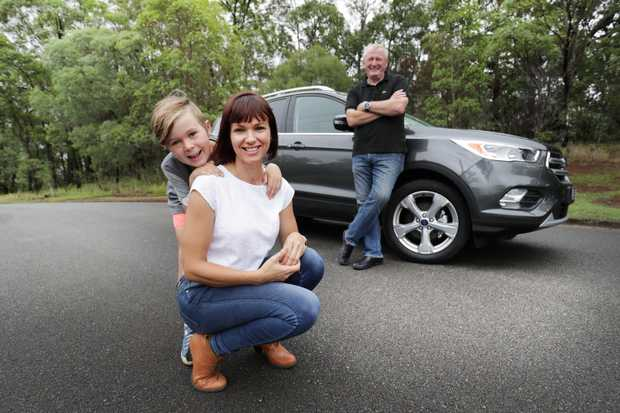 FAMILY CAR: Motoring writer Paul Gover with his wife Ali and their son Eli ready to test the Ford Escape.
