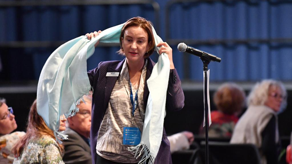 LNP member Brooke Patterson debates a resolution at the Liberal National Party (LNP) state convention in Brisbane.
