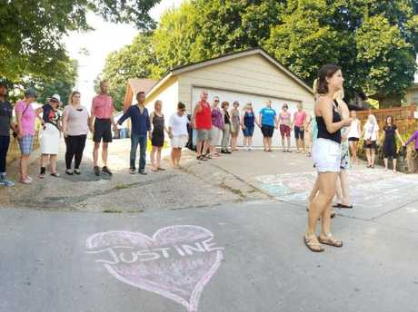 Local residents hold a vigil at the scene of the shooting. Picture: Jeff Wagner/WCCO/Twitter