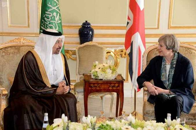 Saudi's Oil Minister Khalid al-Falih, left, poses with British Prime Minister Theresa May,