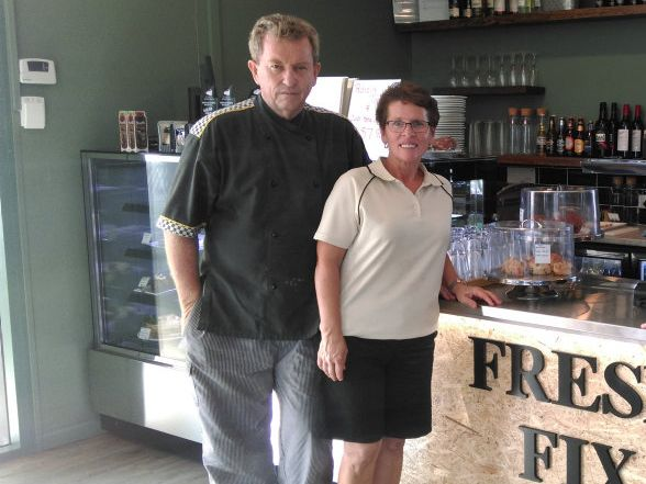 Fresh Fix Cafe owners Tim and Janine Cree in their new restaurant with Anton Guinea.