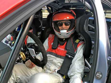 With roll cage, FIA racing seat, harness, full face helmet and HANS device the driver is tightly compacted into the Audi's glorious race interior.