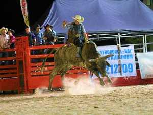 TOUGH STUFF: NSW senior rider David Leake braves the arena at the Torbanlea Rodeo last Saturday.
