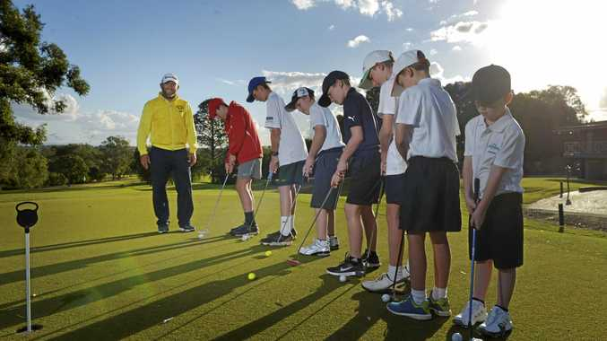 LEARNING CURVE: Australasian and Japanese tour winner Matthew Guyana (left) is nurturing the youth at Ipswich Country Club.