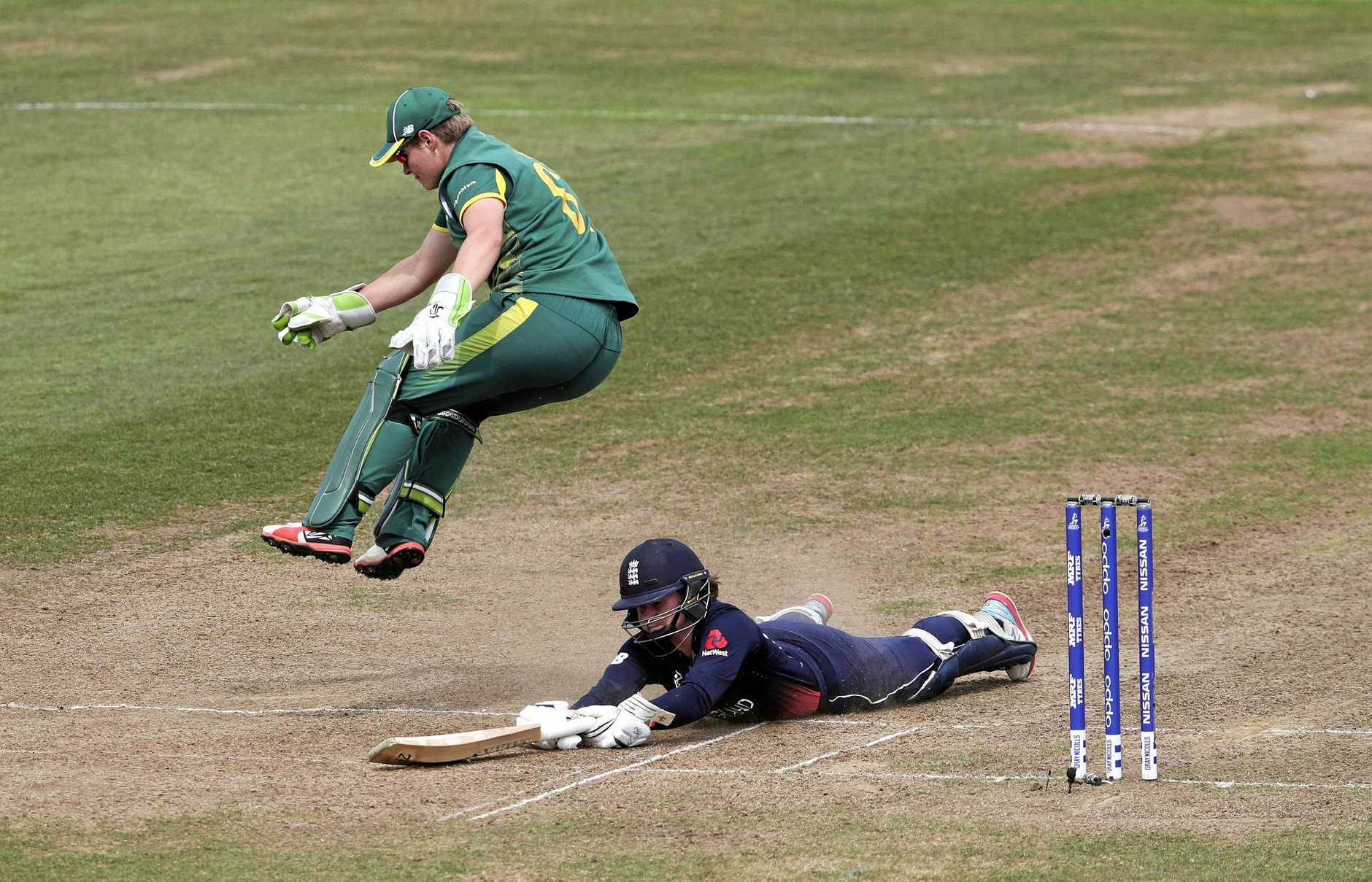 England's Tammy Beaumont dives full length to make her ground as South Africa 'keeper Lizelle Lee takes evasive action during their World Cup semi-final.