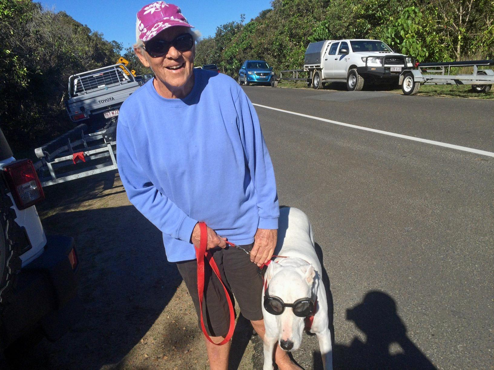 Judy Langford with Lucy, her rescue dog that suffered from sunburn in the eyes until she started wearing Doggles.
