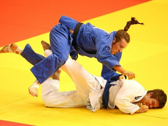 Australian Connor Smith (white) competes against Thomas Lish of England in the boys -90kg judo at the 2017 Youth Commonwealth Games.