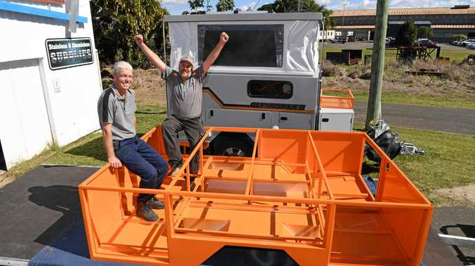 NEW MODEL: Dave Willoughby and Todd Burrows with the powder-coated framework of the new XC-1 camper trailer from Kelly Campers.