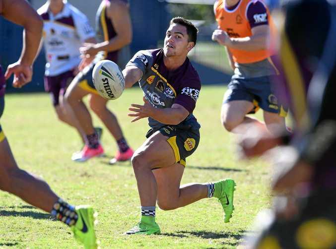 Kodi Nikorima (centre) chimes in from fullback during Brisbane's training on Wednesday.