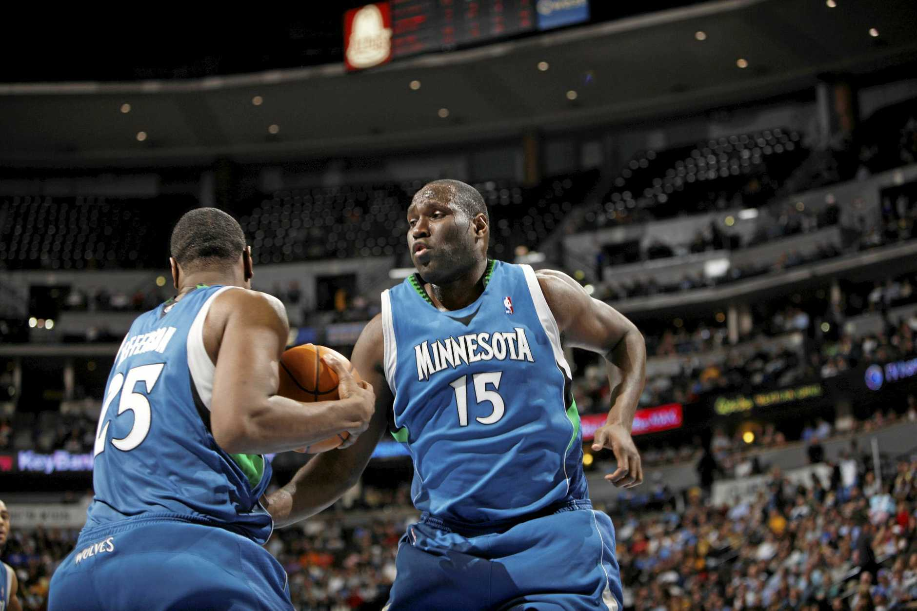 Minnesota Timberwolves forwards Al Jefferson, left, and Nathan Jawai, of Australia, get tangled up while pulling down a rebound while facing the Denver Nuggets during the Nuggets' 105-94 victory in an NBA basketball game in Denver on Monday, Jan. 11, 2010. (AP Photo/David Zalubowski)