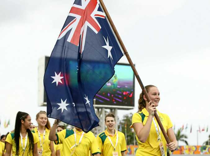 Riley Day leads the Australian team out during the opening ceremony of the 2017 Youth Commonwealth Games in the Bahamas.