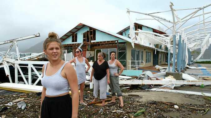 BLOWN APART: Airlie Beach residents Maika McDonald,15, Lauren Squires, Karen Gordon, and Katelin Gordon, survey the damage at Shute Harbour after cyclone Debbie.