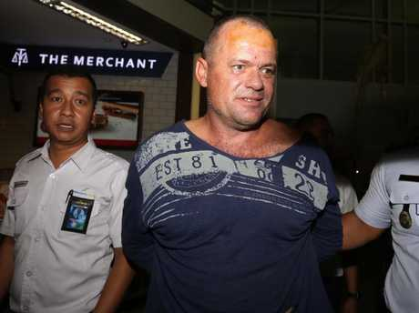 Photos of Australian man Gregory Butler escorted out of Bali airport after a 90-minute stand off with authorities. Picture: Supplied