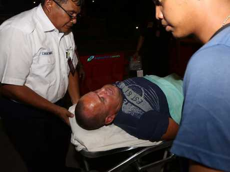 Australian man Gregory Butler, right, before being escorted out of the airport and to hospital. Picture: Supplied
