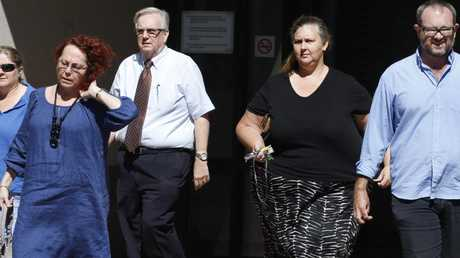 Edge Hill State School Principal Paul Campbell 3rd from left and president of the Edge Hill Parents and Citizens association Kier Shorey were among a group of people who left court after Tamara May Brier-Mills was jailed for six months for fraudulently taking funds from the Edge Hill State School P&C Association's after school hours care. PICTURE: ANNA ROGERS