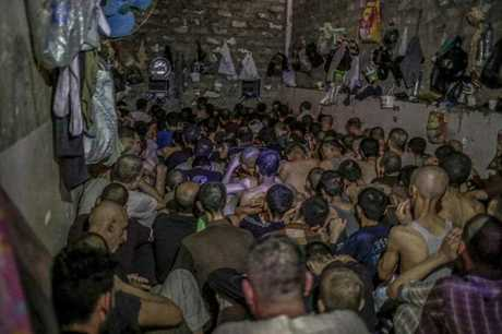 Hundreds of suspected Islamic State members swept up by Iraqi forces in Mosul are being held in a cramped and stifling prison just outside the city. (AP Photo/Bram Janssen)