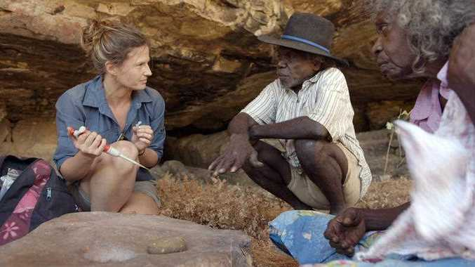 Elspeth Hayes with Mark Djandjomerr and traditional owner May Nango extracting comparative samples at a cave adjacent to the Madjedbebe rock shelter in the Kakadu National Park in the Northern Territory.
