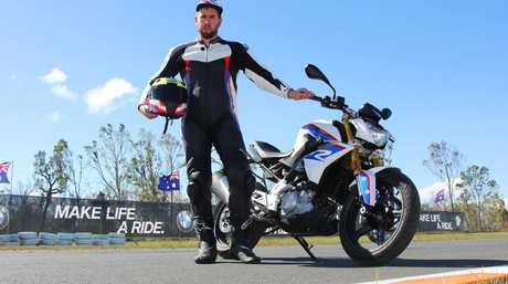 National marketing manager of BMW Australia, Nigel Harvey, shows off the new BMW G310R at the Gunyarra race track near Proserpine on Tuesday.