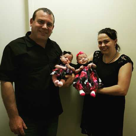 Mackay's Sarah Atkins and Terry Johnson with their four-month-old twin daughters, Jorja and Aleira.