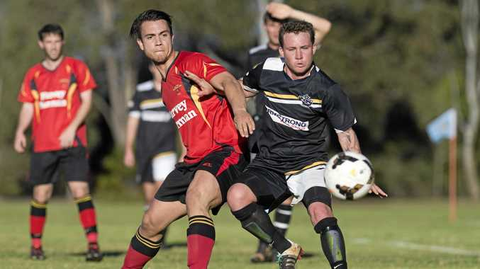 IN ACTION: Gatton's Zachary Kaddatz and Ashley Freier of West Wanderers in action.