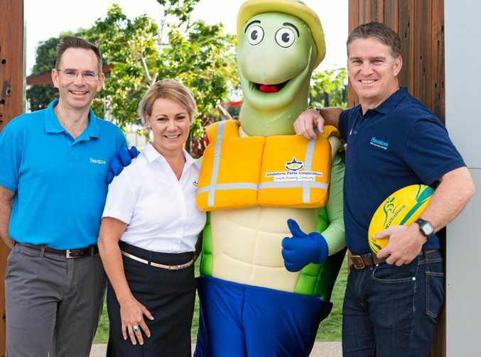 READY TO RUN: Santos GLNG general manager downstream operations Brenton Hawtin, Gladstone Ports Corporation general manager people and community Rowen Winsor, Curtis the Turtle and Tim Horan.