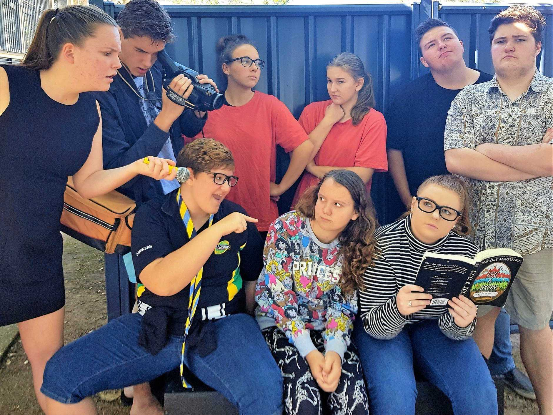 The cast of Spitting Chips in rehearsal for their play to be performed at the Urangan High School.