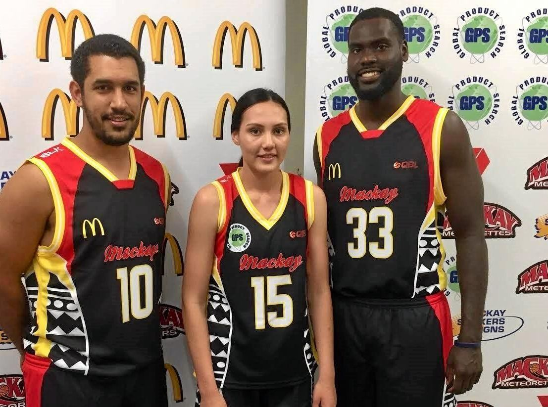 Mackay Meteorette Denesha Bobongie and Meteors Chris Cedar and TJ Diop wear the NAIDOC jerseys the teams will play in on Friday night.