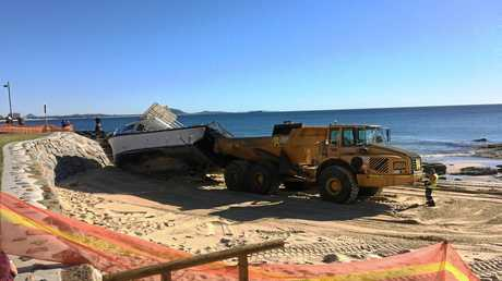 RUN AGROUND: Crews are preparing to drag the boat off the beach.